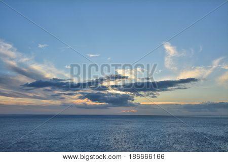 Beautiful sunset over Caribbean Sea. Clouds on blue sky