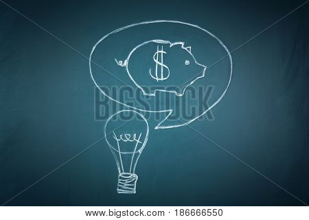 Chalk drawing of piggy bank and light bulb on board