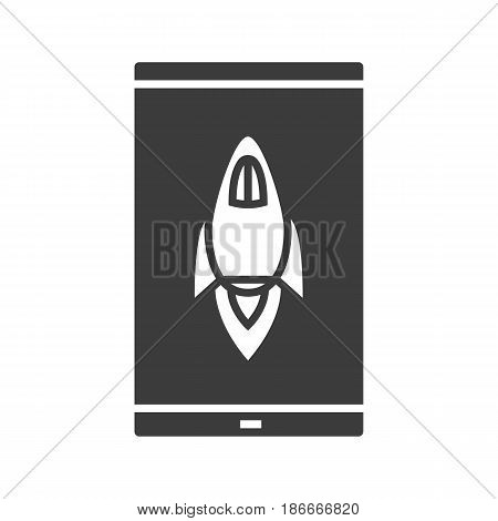 Smartphone boost app glyph icon. Silhouette symbol. Smart phone with spaceship. Negative space. Vector isolated illustration