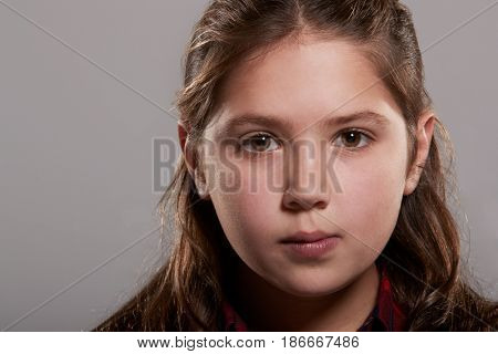 Ten year old girl looking to camera, close up