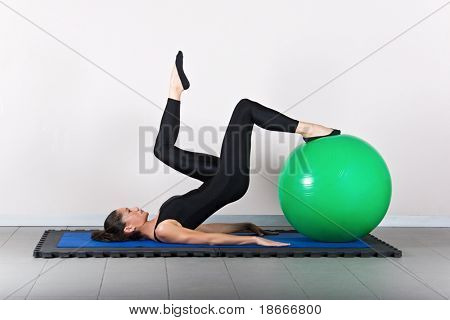 Hamstring curl one leg   with ball position. Pilates gymnastics is a Germanic evolution of yoga, used by athletes to improve flexibility and body fitness and by chiropractors for patient recovery.