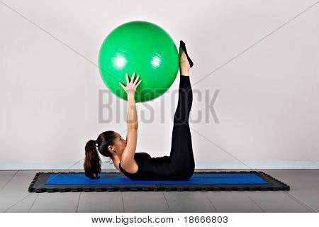 Pike with ball position. Pilates gymnastics is a Germanic evolution of yoga, used by athletes to improve flexibility and body fitness and by chiropractors for patient recovery.