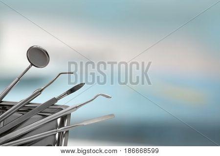 Dental tools on blurred background