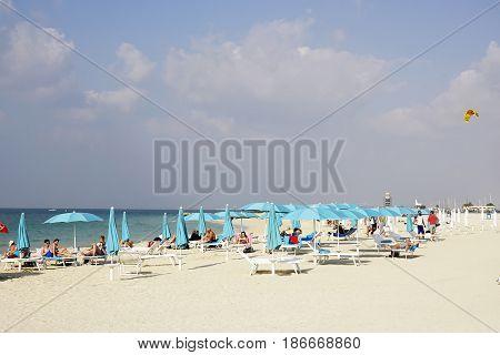 DUBAI, UAE - 8 JANUARY 2017: People on the Beach in Dubai, UAE, Asia
