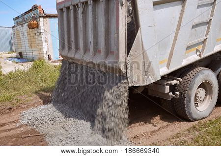Dumper truck for unloading rubble on the road construction site.
