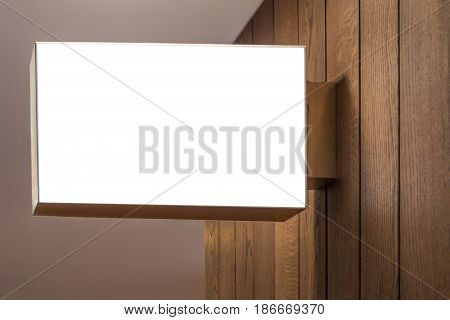 Horizontal rectangular white empty signage mock up of store, shop in shopping mall
