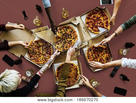 Group of people enjoy the italian cuisine pizza