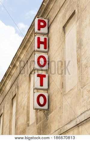 An Old Sign Of A Street Photography Store