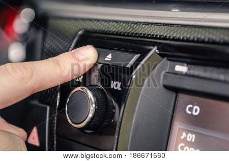 Pressing The Eject Cd Button Of A Car