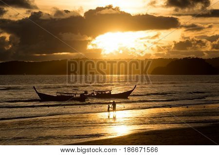 Landscape long tail Boat on beach and sun light at evening time