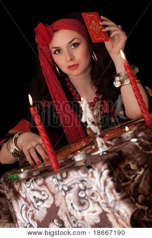 Gypsy Woman Sitting With Cards. Isolated