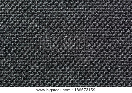 Texture of black synthetic rough fabric close-up