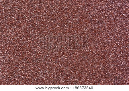 Texture of brown water-resistant sandpaper with high detail