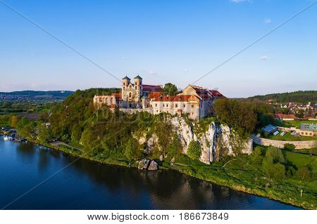 Benedictine monastery on the rocky hill in Tyniec near Cracow, Poland and Vistula River. Aerial view at sunset.