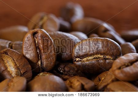 Roasted coffee beans closeup with shallow depth of field