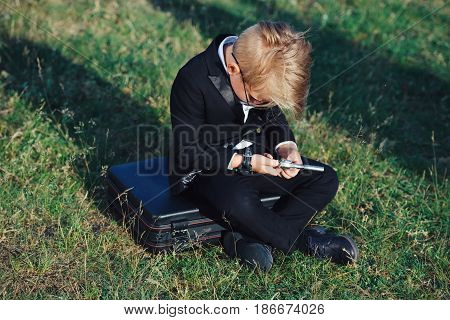 photo of little boy playing secret agent