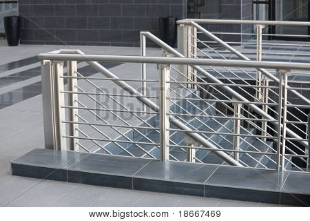 architectural details, modern stainless steel balustrade, and black marble floor