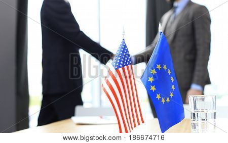 European Union and American leaders shaking hands on a deal agreement