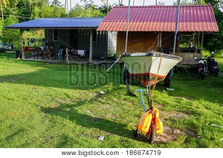 Labuan,Malaysia-May 13,2017:Houses with fisherman boat in Malay traditional Nagalang village at Labuan,Malaysia.Nagalang village is a populated place in Labuan,Malaysia,Asia.
