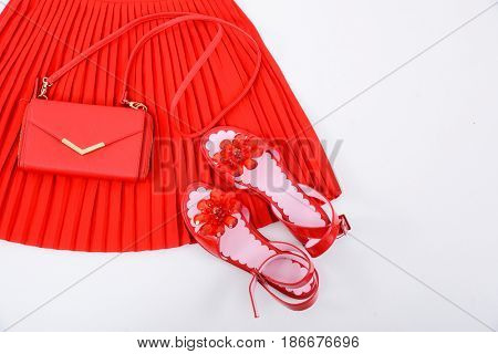 Red handbag , shoes ,skirt on a white background