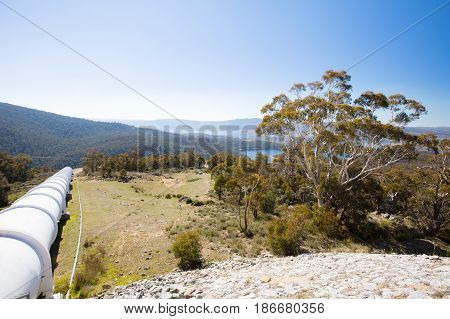 The Snowy Mountains Hydro scheme surge tank on Kosciusko Rd on a sunny autumn day in New South Wales, Australia