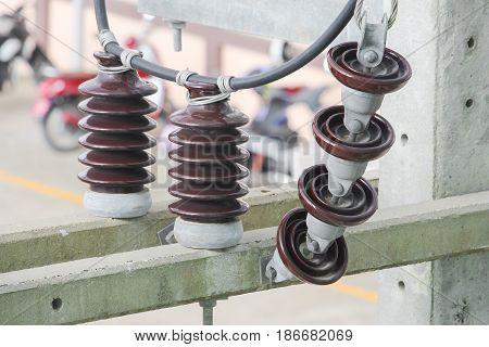 Electricity porcelain insulator on pole close up.
