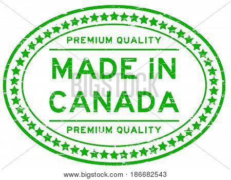 Grunge green premium quality made in Canada oval rubber seal stamp on white background