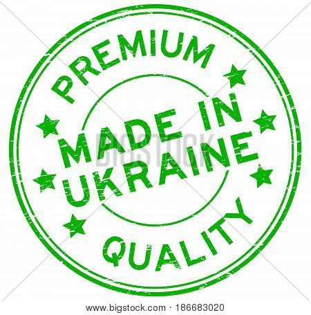 Grunge green premium quality made in Urkaine round rubber seal stamp on white background