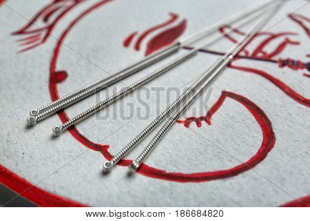 Acupuncture needles on packaging, closeup