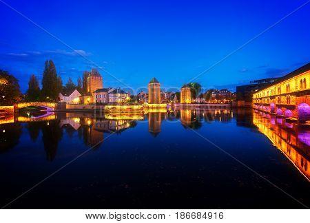 medieval bridge Ponts Couverts and barrage Vauban, night scene of Strasbourg, France, retro toned