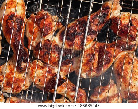 Marinated Grilled chicken Leg on the barbecue grill