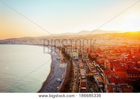 cityscape of Nice with beach and sea at sunset, French Riviera, France, retro toned