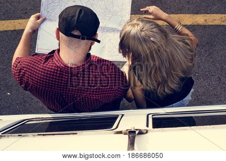 People Checking The Map for Direction on Road Trip