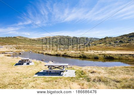 The Kosciusko Road at Spencers Creek near Perisher on a sunny autumn day in New South Wales, Australia