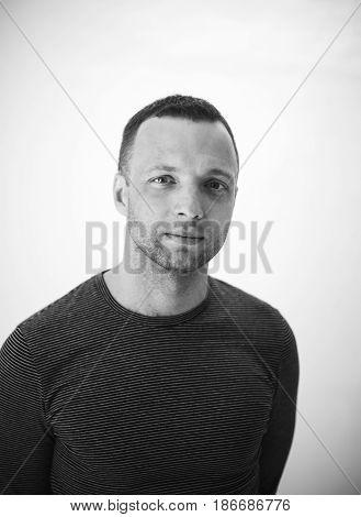 Studio Portrait Of Young Adult European Man