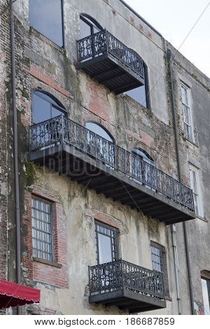 Savannah Georgia USA - January 20 2017: Historical wrought iron balconies and architecture along River Street a popular tourist destination in Savannah Georgia