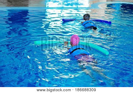 Swim swimming boy girl swimming noodle pool noodle woggle