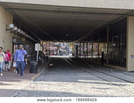Savannah, Georgia, USA - January 20, 2017: Part of the waterfront Riverwalk seen through the tunnel like passageway that divides it. Also called River Street Home the Riverwalk is a popular destination for locals and tourists