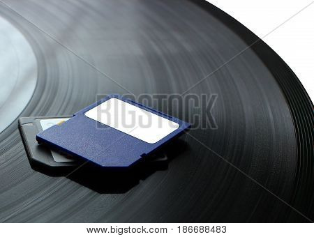 The technology change from a gramophone disk to a SD card