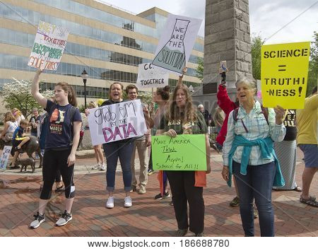 Asheville, North Carolina USA - April 22, 2017: A crowd of demonstrators holds signs and speak up to promote science in downtown Asheville's Pack Square