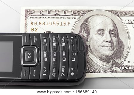 Mobile phone telephone cell phone communication keypad one hundred dollar bill currency