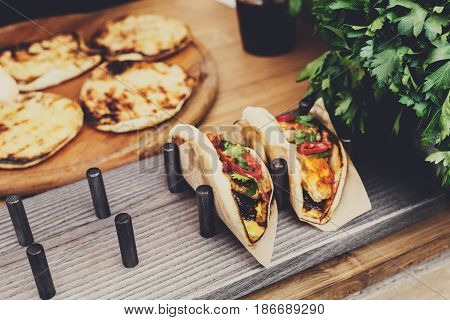 Street vendor sale taco outdoors. Mexican cuisine snacks, fast food of commercial kitchen.