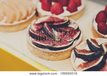 Fig tart closeup. French Bakery catering. Filtered, shallow depth of field