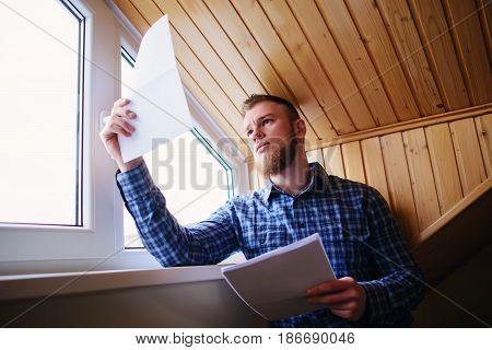 Businessman At Home, He Is Working With Of Paper