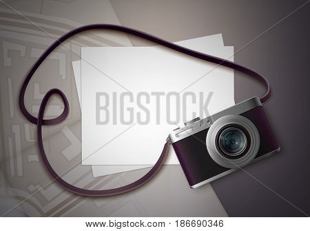 Vector compact photo camera with belt and blank pictures for copyspace top view on table
