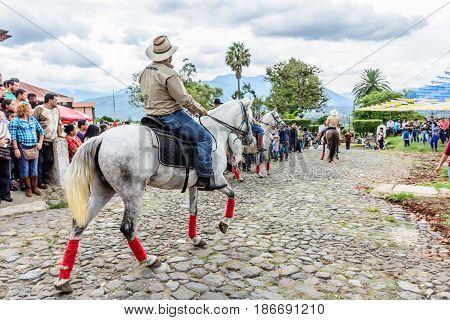 San Juan del Obispo, Guatemala - June 12 2016: Horseback cowboy rides in horse street parade in village near Antigua, Guatemala