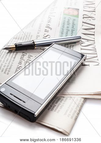 Writing utensil writing instrument newspaper mobile phone phone cell phone isolated on white
