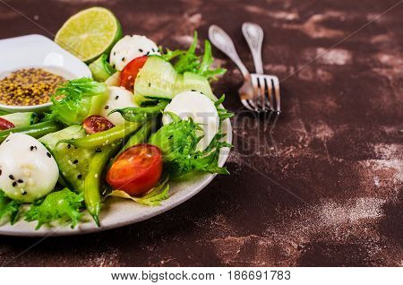 Salad of vegetables with mozzarella. Selective focus.