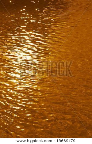 golden swimpool water background on sunset light