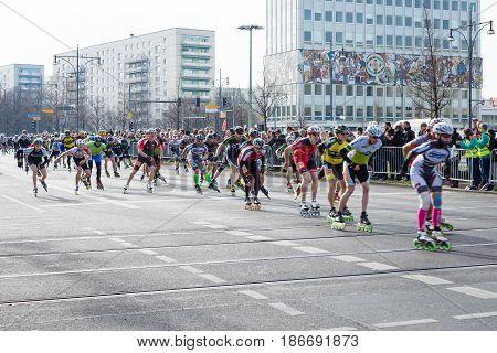 BERLIN - APRIL 03 2016: The annual Berlin Half Marathon. Race through the city streets. Race athletes on roller skates.